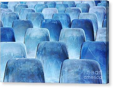 Rows Of Blue Chairs Canvas Print by Carlos Caetano