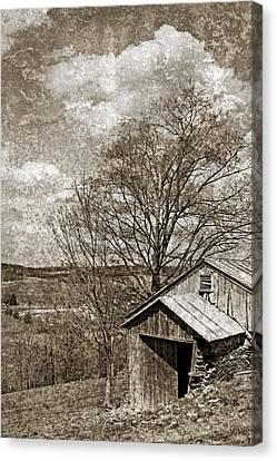 Rustic Hillside Barn Canvas Print by John Stephens