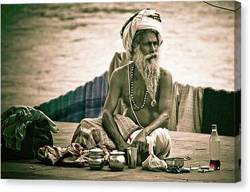 Sadhu At Ganges Canvas Print by John Battaglino