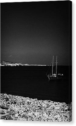 Sailing Boat Moored In A Quiet Bay Near Cape Gkreko Greco Republic Of Cyprus Canvas Print by Joe Fox