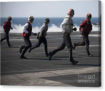 Sailors Clear The Landing Area Canvas Print by Stocktrek Images