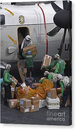 Sailors Load Mail On To A C-2a Canvas Print by Stocktrek Images