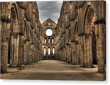 San Galgano  - A Ruin Of An Old Monastery With No Roof Canvas Print by Joana Kruse