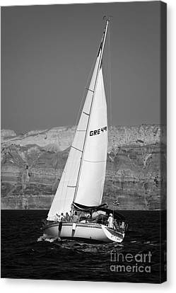 Santorini Sail Canvas Print by Leslie Leda