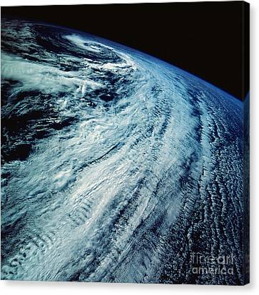 Satellite Images Of Storm Patterns Canvas Print by Stocktrek Images