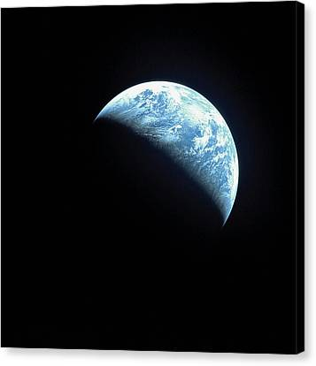 Satellite View Of A Partially Hidden Earth Canvas Print by Stockbyte