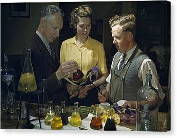 Scientists Examine Results Of Tests Canvas Print by B. Anthony Stewart