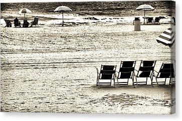Seats On The Beach Canvas Print by John Rizzuto
