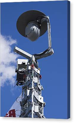Security Camera On Tower. Canvas Print by Mark Williamson