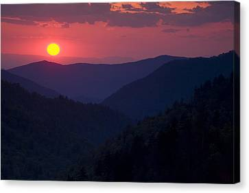 Setting Sun In The Mountains Canvas Print by Andrew Soundarajan