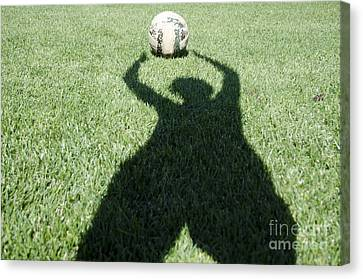 Shadow Playing Football Canvas Print by Mats Silvan