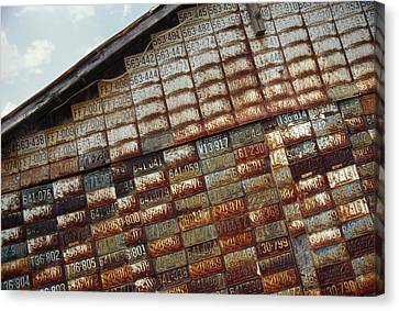 Side Of A Building Adorned With Old Canvas Print by Raymond Gehman