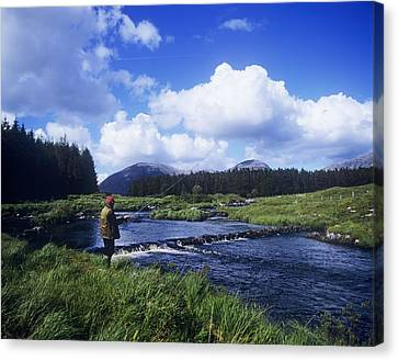 Side Profile Of A Man Fly-fishing In A Canvas Print by The Irish Image Collection
