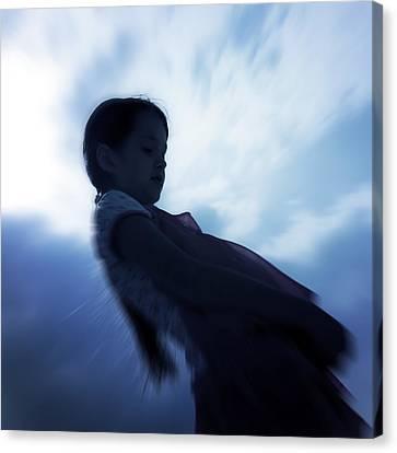 Silhouette Of A Girl Against The Sky Canvas Print by Joana Kruse