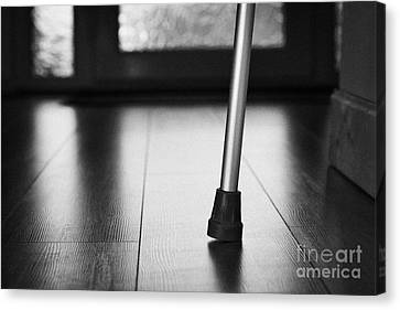 Single Crutch Leg Leaning Against A Wall In A House In The Uk Canvas Print by Joe Fox