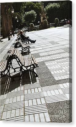 Sitting In The Park - Madrid Canvas Print by Mary Machare