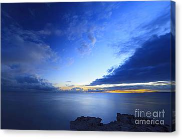 Sky And Sea At Sunset Canvas Print by Nino Rasic