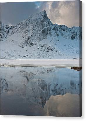 Snow Covered Mountain Reflected In Lake Canvas Print by © Peter Boehi