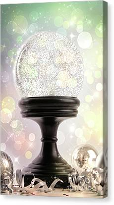Snowglobe With Ornaments Against Colored Background Canvas Print by Sandra Cunningham