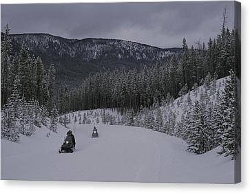 Snowmobilers In Yellowstone National Canvas Print by Raymond Gehman