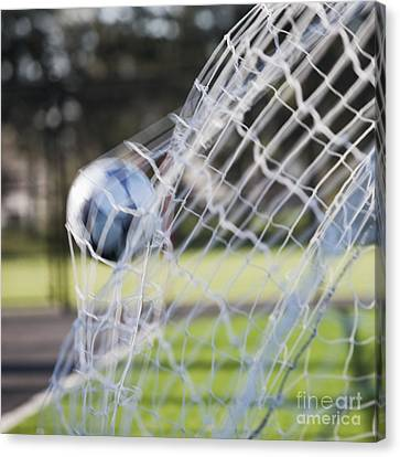 Soccer Ball In Goal Netting Canvas Print by Jetta Productions, Inc