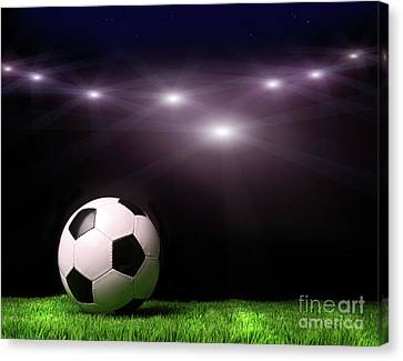 Soccer Ball On Grass Against Black Canvas Print by Sandra Cunningham