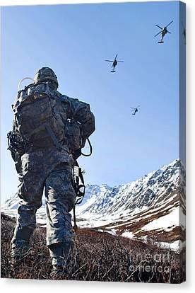 Soldier Patrols Through Alaska's Canvas Print by Stocktrek Images