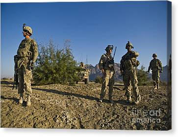 Soldiers Discuss A Strategic Plan Canvas Print by Stocktrek Images