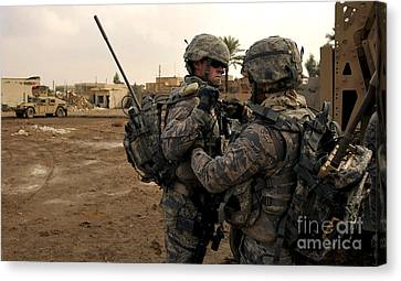 Soldiers Help One Another Canvas Print by Stocktrek Images