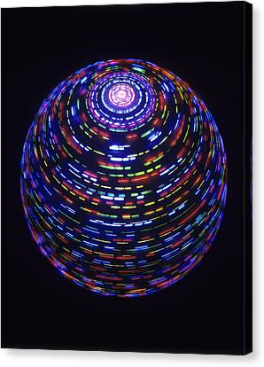Spinning Globe Canvas Print by Lawrence Lawry