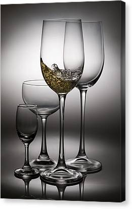 Splashing Wine In Wine Glasses Canvas Print by Setsiri Silapasuwanchai