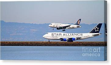 Star Alliance Airlines And Frontier Airlines Jet Airplanes At San Francisco Airport . Long Cut Canvas Print by Wingsdomain Art and Photography