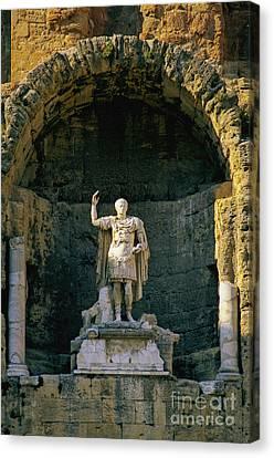 Statue De L'empereur Auguste Dans Le Theatre D'orange. Canvas Print by Bernard Jaubert