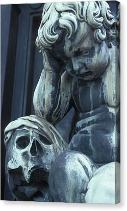 Statue Of A Child Angel Contemplating Canvas Print by Stephen Sharnoff