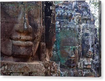 Stone Heads At Bayon Temple Canvas Print by Carson Ganci