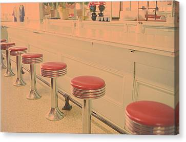 Stools At Bar Counter Canvas Print by Carol Whaley Addassi