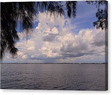 Storm Across The River Canvas Print by Rosalie Scanlon