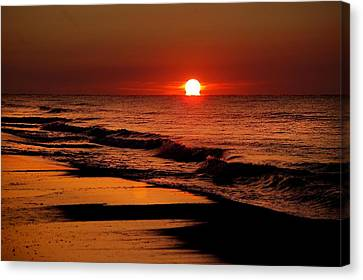 Sun Emerging From The Water Canvas Print by Michael Thomas