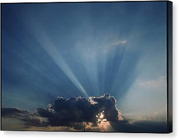 Sun Rays And Cumulus Cloud Canvas Print by Pekka Parviainen