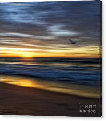 Sunrise Over The Ocean Canvas Print by Diane Metz