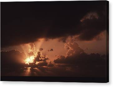 Sunset And Clouds Over Water Canvas Print by Ira Block