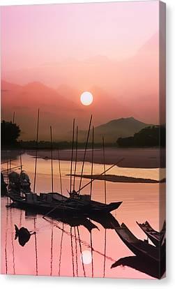 sunset at Mae Khong river Canvas Print by Setsiri Silapasuwanchai