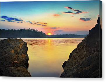 Sunset Between The Rocky Shore Canvas Print by Steven Llorca