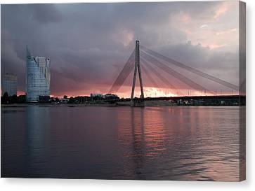 Sunset In Riga Canvas Print by Claudia Fernandes