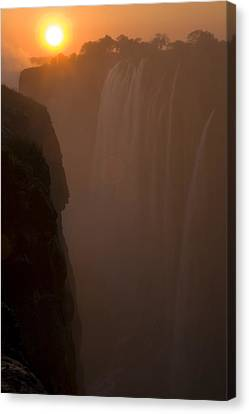 Sunset Over Cascading Victoria Falls Canvas Print by Ralph Lee Hopkins