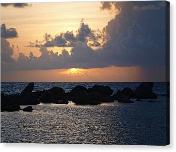 Sunset Over The Ocean Canvas Print by Philip G