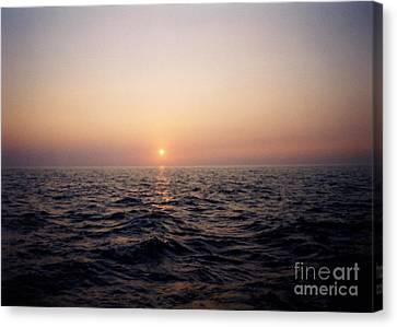 Sunset Over The Ocean Canvas Print by Thomas Luca