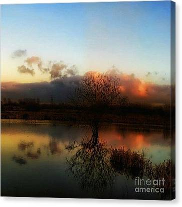 Sunset Reflections Canvas Print by Isabella Abbie Shores