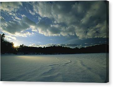 Sunset Viewed From The Frozen Surface Canvas Print by Tim Laman