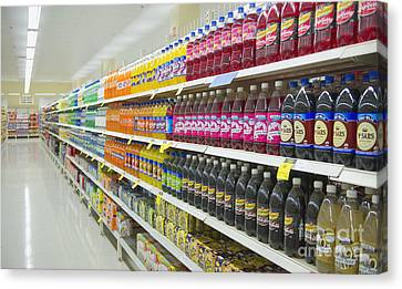 Supermarket Shelves And Aisle Canvas Print by Dave & Les Jacobs